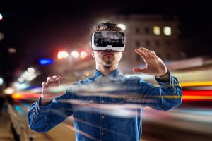 53460575 - double exposure of man wearing virtual reality goggles and night city